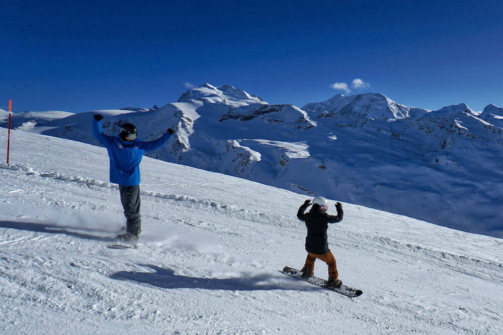 kids snowboard lessons with an instructor in Zermatt